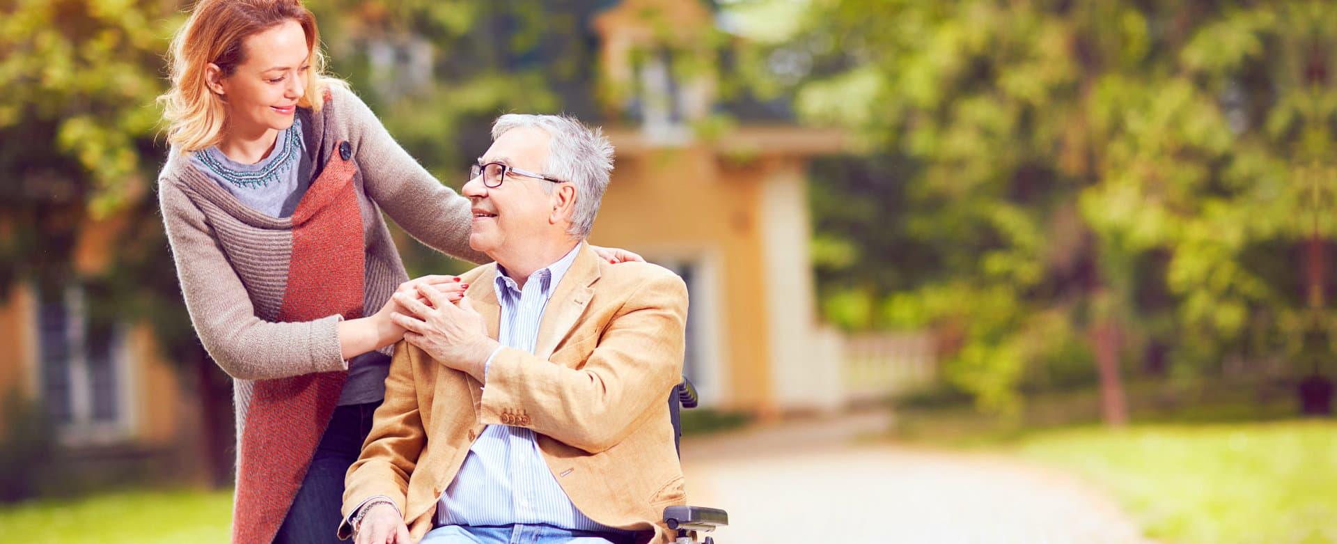 female caregiver and senior man smiling