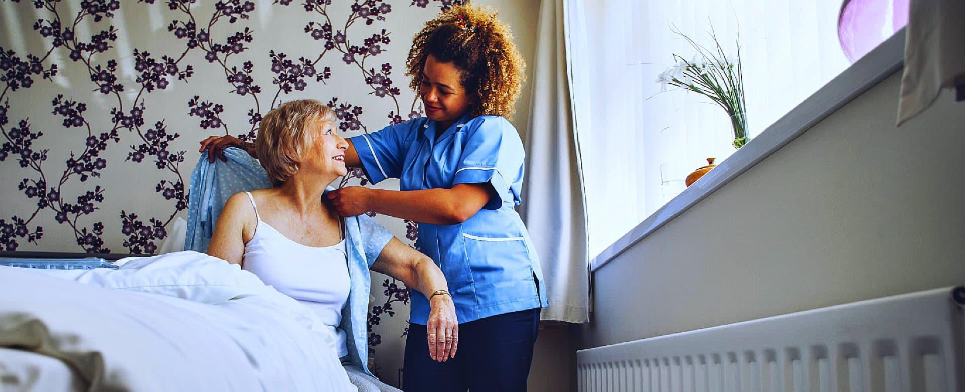 female caregiver assisting senior woman